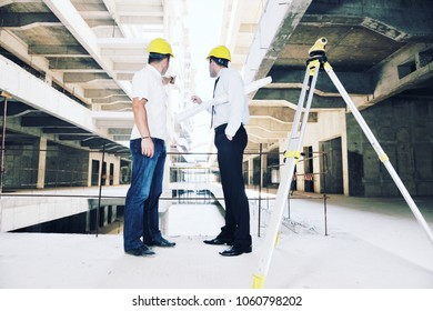 Team of business people in group, architect and engeneer  on construciton site check documents and business workflow on new building