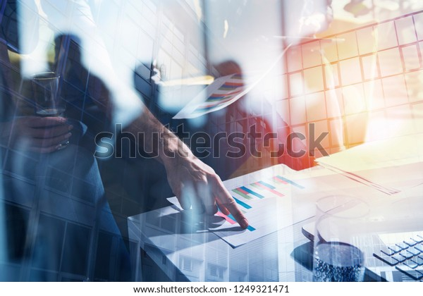 Team of business person works together on company statistics. Concept of teamwork. Double exposure