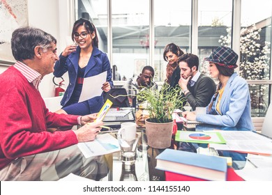 Team of businessmen sharing ideas in a conference meeting - Creative team brainstorming in a modern office