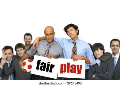 Team of  businessmen with soccer ball and white cards with the words fair play isolated in white