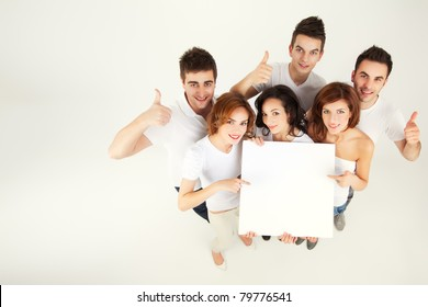 team of casual young people holing blank banner