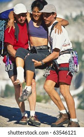 Team of climbers give first-aid and carry their injured partner out of the wilderness.