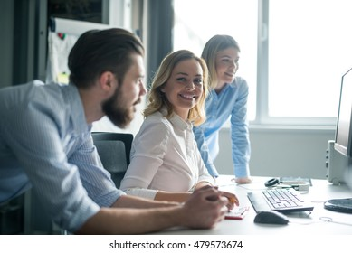Team of colleagues working together in an office.