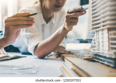 Team of Construction engineering or architect hands working on blueprint inspection in workplace, drawing and sketching meeting for architectural project working with partner.