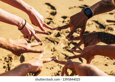 Team and cooperation friendship together concept with group of caucasian young hands doing victory sign under the sunny day of summer - friends and youthful united forever