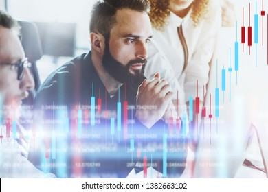 Team of crypro stock traiders sitting front of computer with technical price graph and indicator, red and green candlestick chart and stock trading computer screen background. Double exposure