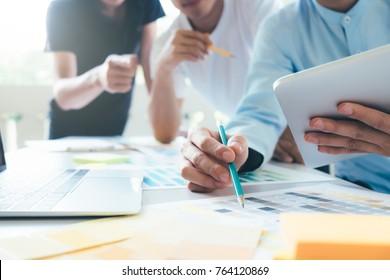 Team of Designer working at office. Designers brainstorming meeting team.