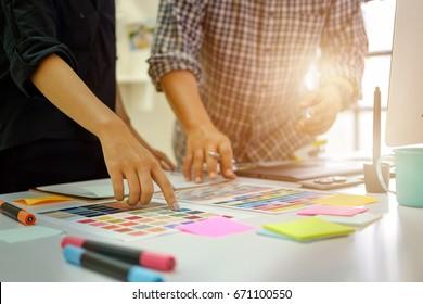 Team of Designers working at office. Designers Brainstorming.
