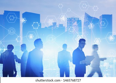 Team of diverse businessmen working together with documents in city with double exposure of digital business interface. Concept of hi tech and teamwork. Toned image blurred