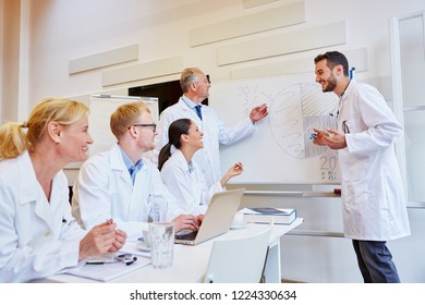 Team of doctors during medical training workshop learning with joy