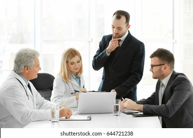 Team of doctors having consultation in clinic
