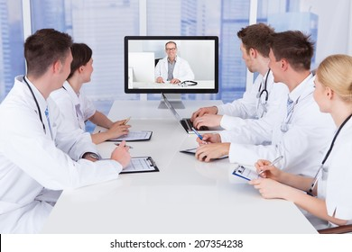 Team of doctors having video conference meeting in hospital