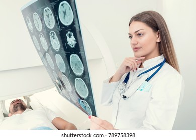 Team of doctors looking at radiology picture, concept