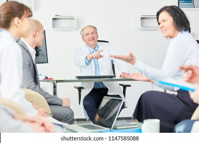 Team of doctors in a meeting dicussion with employee staff