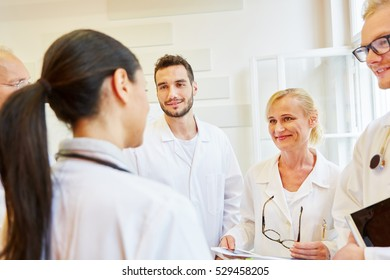 Team of doctors in meeting as teamwork concept in hospital