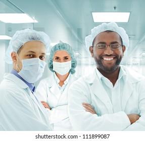 Team of doctors in modern hospital lab