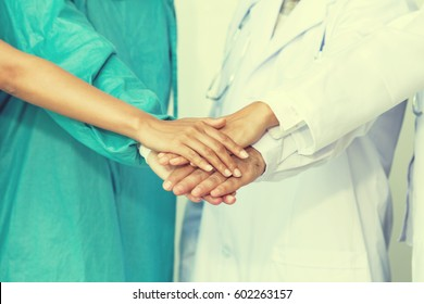 Team doctors multiethnic hands clasp together to express the conviction that working together successfully. Prior to surgery, a special case.