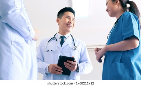 Team of doctors talking in hospital. Group of medical staff discussing in clinic.