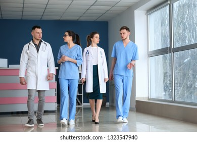 Team of doctors walking down the corridor in clinic