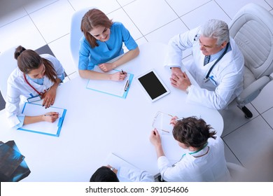 Team of doctors at working place indoors