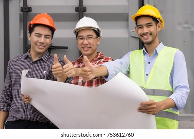Team of engineers and architect  working with plan   at  construction site  showing thumbs up. Success Teamwork Concept.