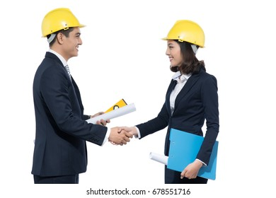 Team of engineers or architects shaking hands standing over white.