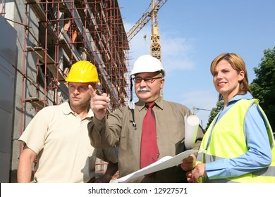 team of engineers at the construction site