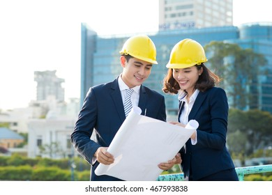 Team of engineers at the construction. Two architects discussion outdoors