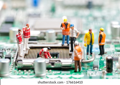 Team of engineers repairing circuit board. Computer repair concept