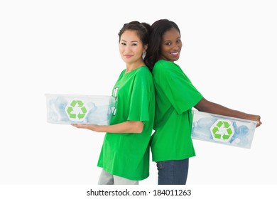 Team of environmental activists standing back to back on white background