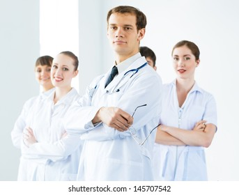 team of experienced highly qualified doctors, fold one's arms