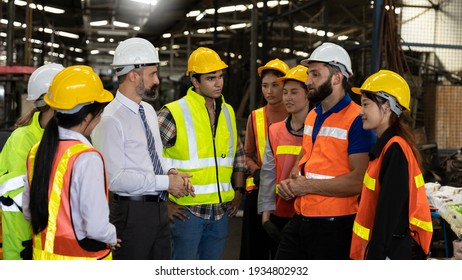 Team of factory workers or technicians celebrate the success together. Collective appreciation and team effort in a factory. Leadership in teamwork