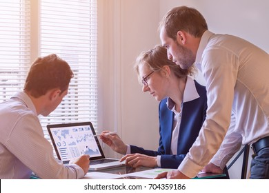 Team of finance people discussing charts and key performance indicator (KPI) on computer screen with business intelligence (BI) in meeting room, corporate revenue, fintech
