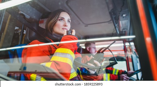 Team of fire fighters driving to an operation using radio