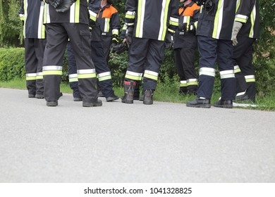 A Team of Firefighters discussing pausing just Feet
