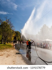 A team of firefighters holds a demonstration and practice in small rural community.