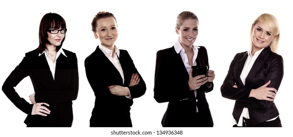 A team of four business women on a white background. Business women.