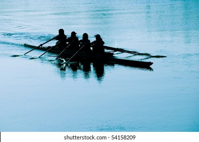 team of four, during canoe rowing training