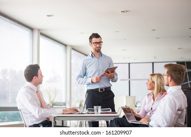Team of four people meeting in office