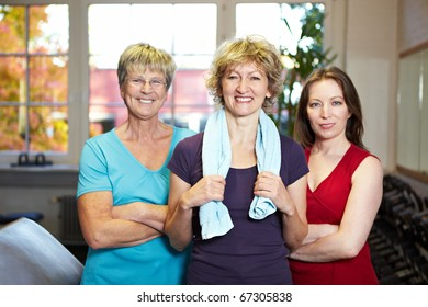 Team group of three females in a gym