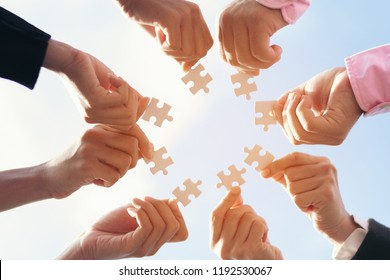 team hand power full man and woman placing the  jigsaw puzzle piece for trust business partner and connection solution  concept worker  unity team.
