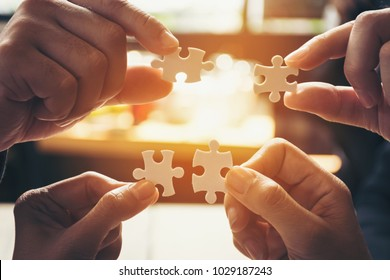 team hand power full  hand placing the  jigsaw puzzle piece for conect business partner and connection start up new project concept worker  unity team.