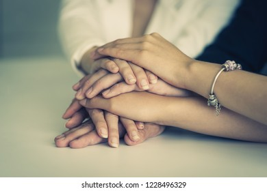 Team hand together in business meeting for team concept