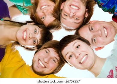 A team of happy young people. From below