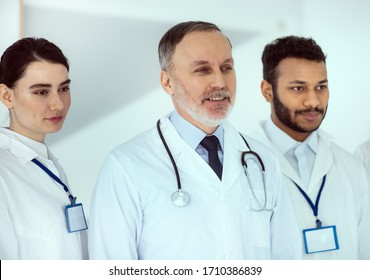 Team of healthcare workers wearing white lab coats stock photo