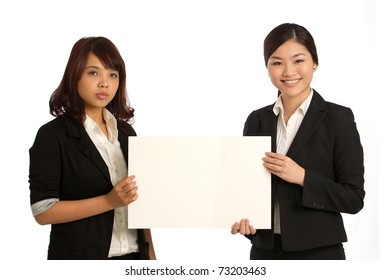 Team holding a blank sign with room for you to add your own message