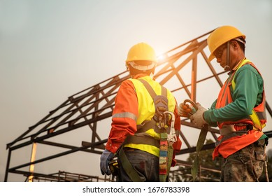Team of Home Construction Builder checking the safety equipment.Before starting to work on the construction site,.safety first concept image
