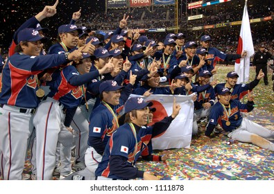 "Team Japan players give ""number one"" signs while posing for pictures during celebrations following their 10-6 victory over Cuba to win the 2006 World Baseball Classic ."