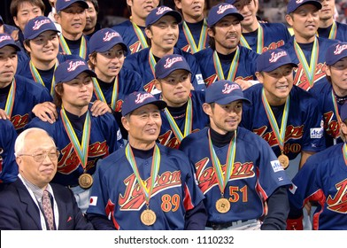 Team Japan poses for pictures during celebrations following their 10-6 victory over Cuba to win the 2006 World Baseball Classic at Petco Park in San Diego March 20, 2006.