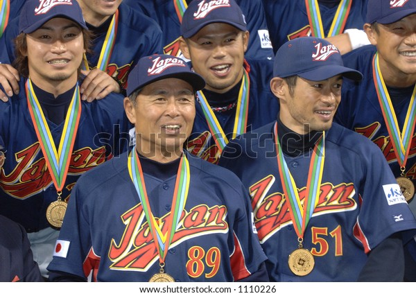 Team Japan poses for pictures during celebrations following their victory over Cuba.